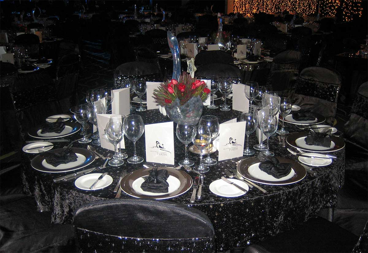 IBM Recognition Dinner in Perth featured acrylic swan centrepieces and black table settings